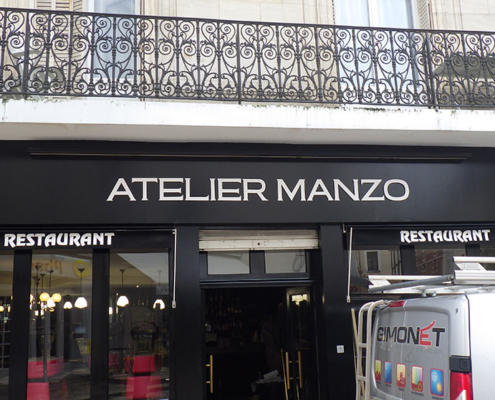Enseigne pour le restaurant Atelier Manzo
